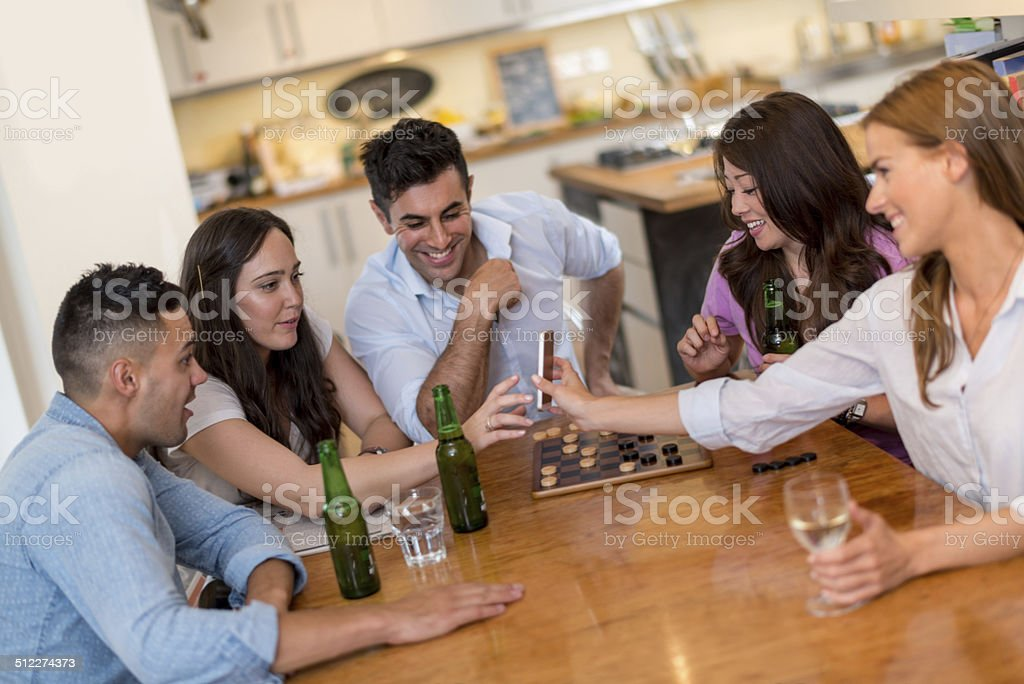 Friends having fun at home stock photo