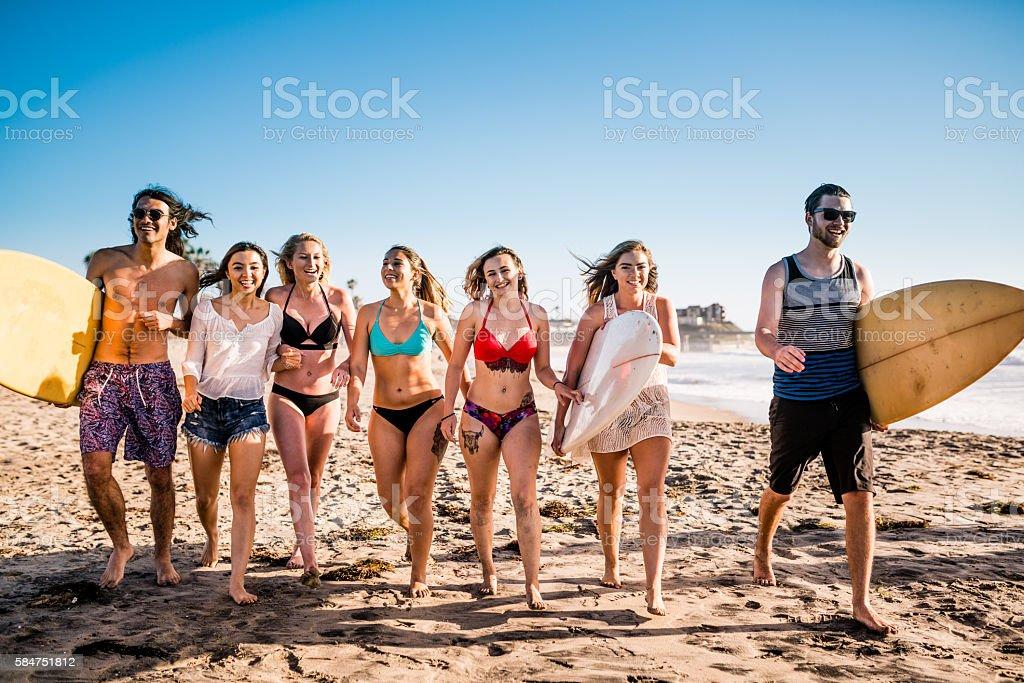 Friends having fun at San Diego beach stock photo