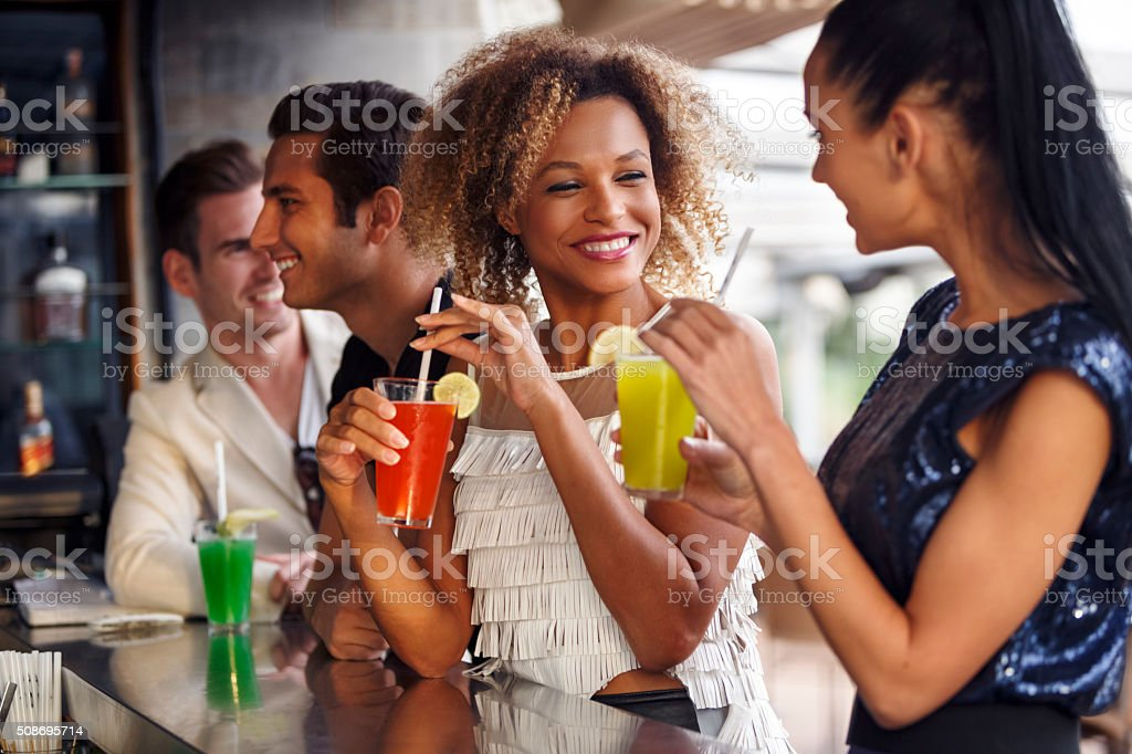 Friends having fun at the bar outdoor stock photo