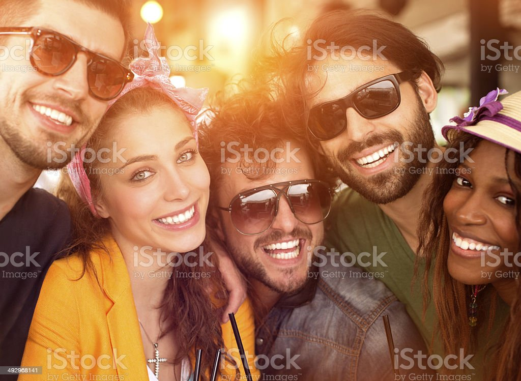 Friends having fun at the bar. stock photo