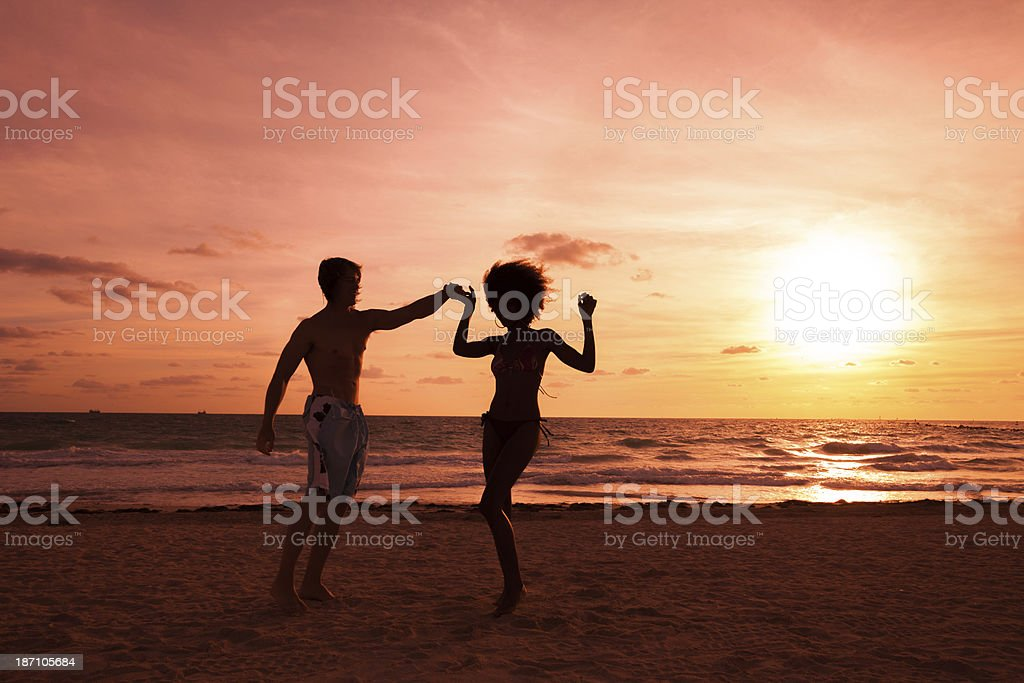 Friends having fun at the beach royalty-free stock photo