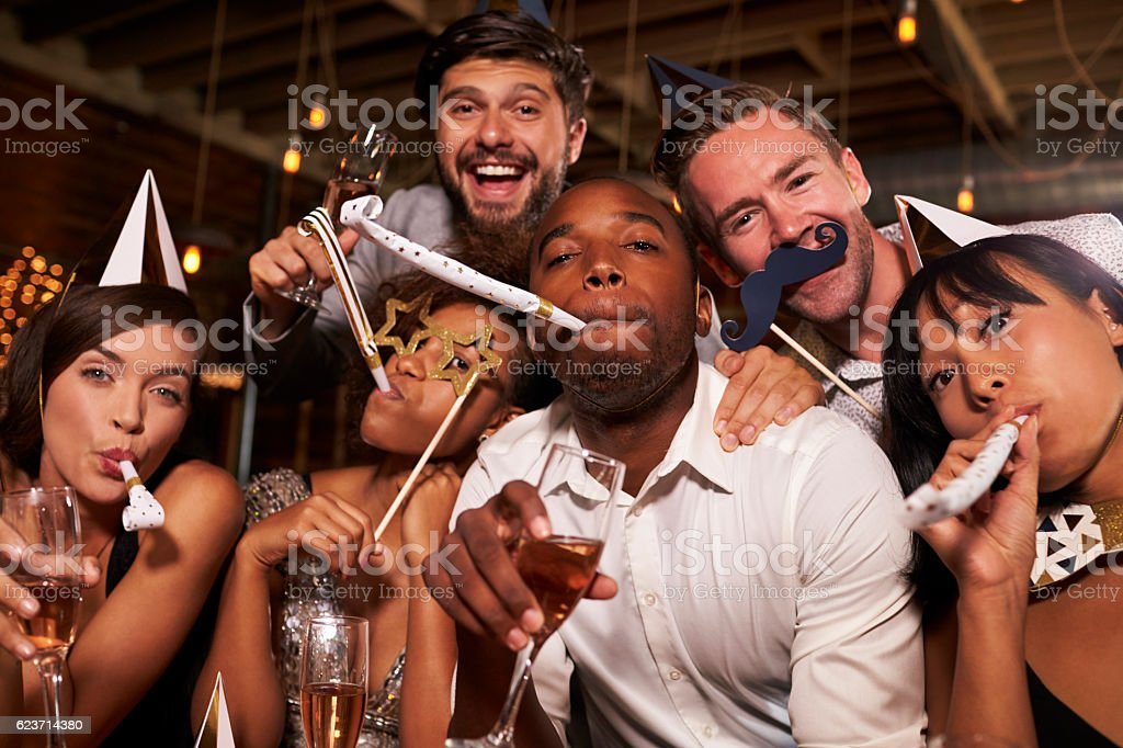 Friends having fun celebrating New Year at a bar, stock photo