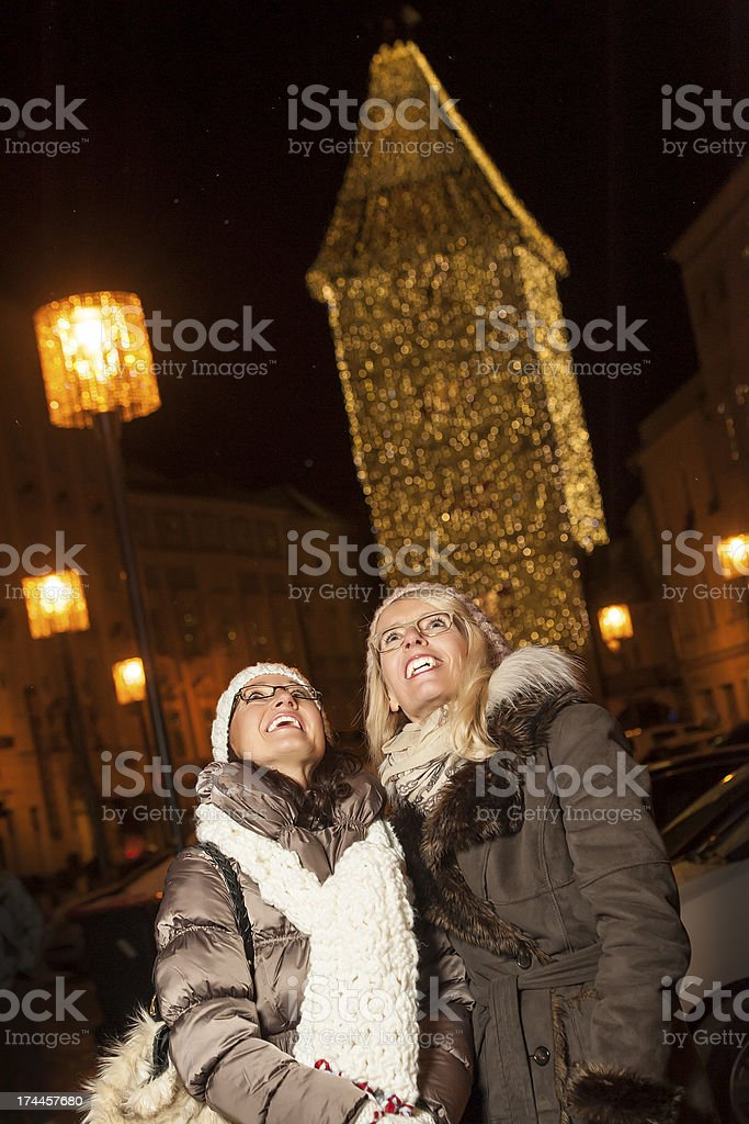 Friends having fun during Christmas shopping royalty-free stock photo