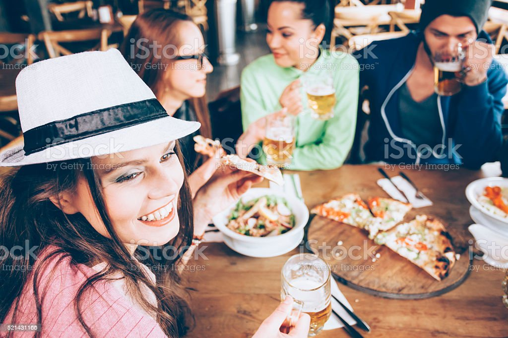 Friends having fun in a bar together stock photo