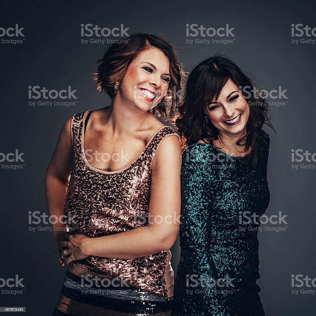 Friends having fun in festive clothing stock photo