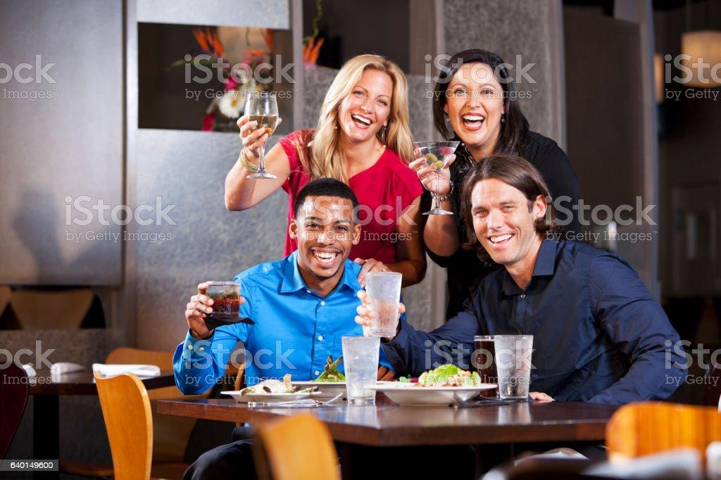 Friends having fun in restaurant stock photo