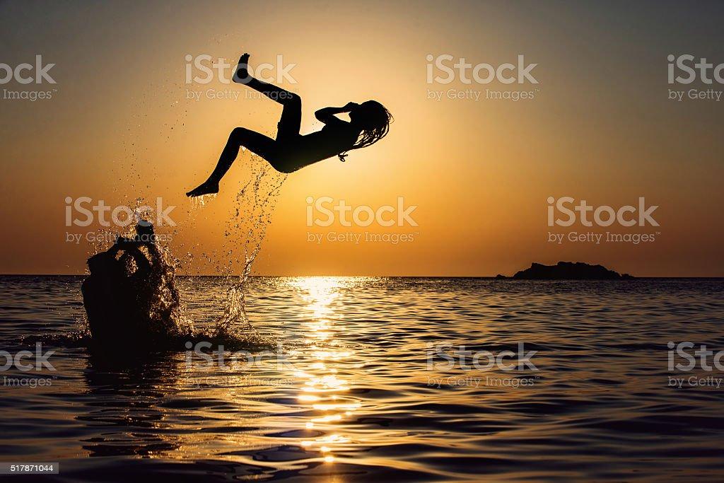 Friends having fun in water stock photo