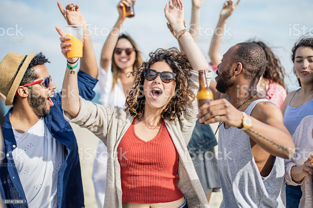 Friends having fun on a party at the beach stock photo