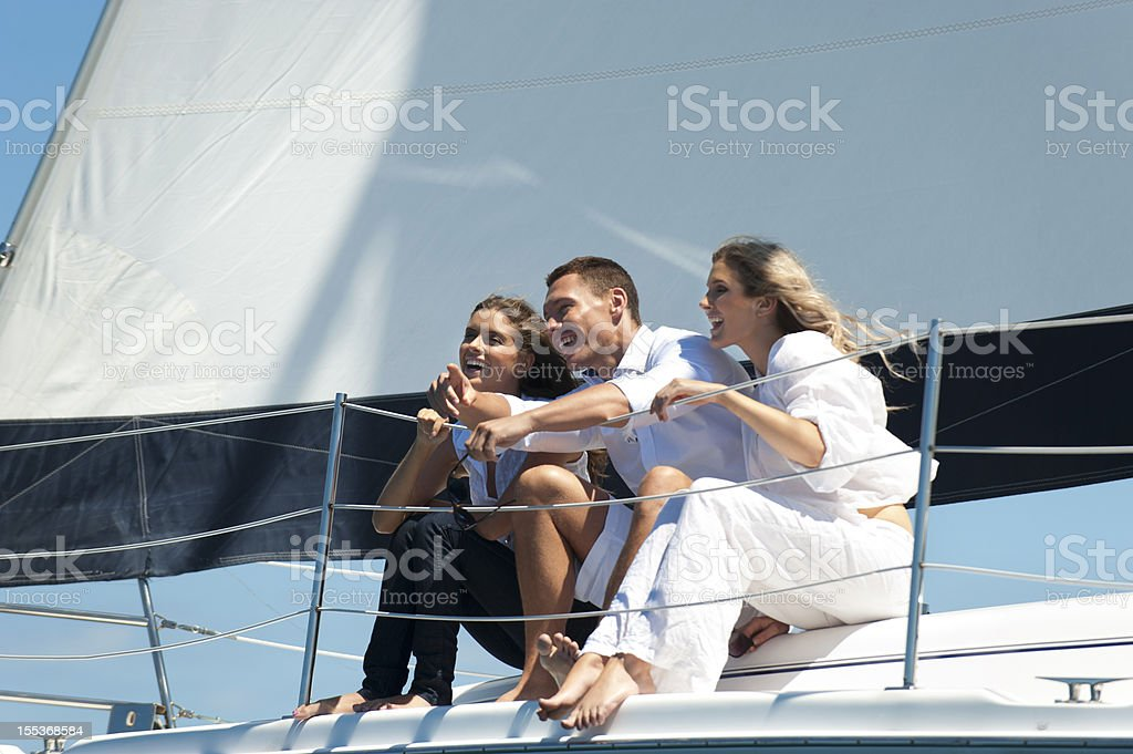 Friends having fun on a sail boat royalty-free stock photo