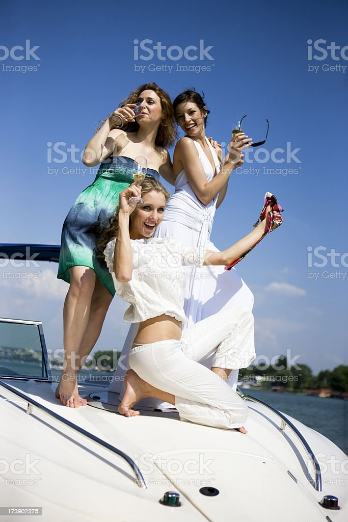 Friends having fun on boat royalty-free stock photo