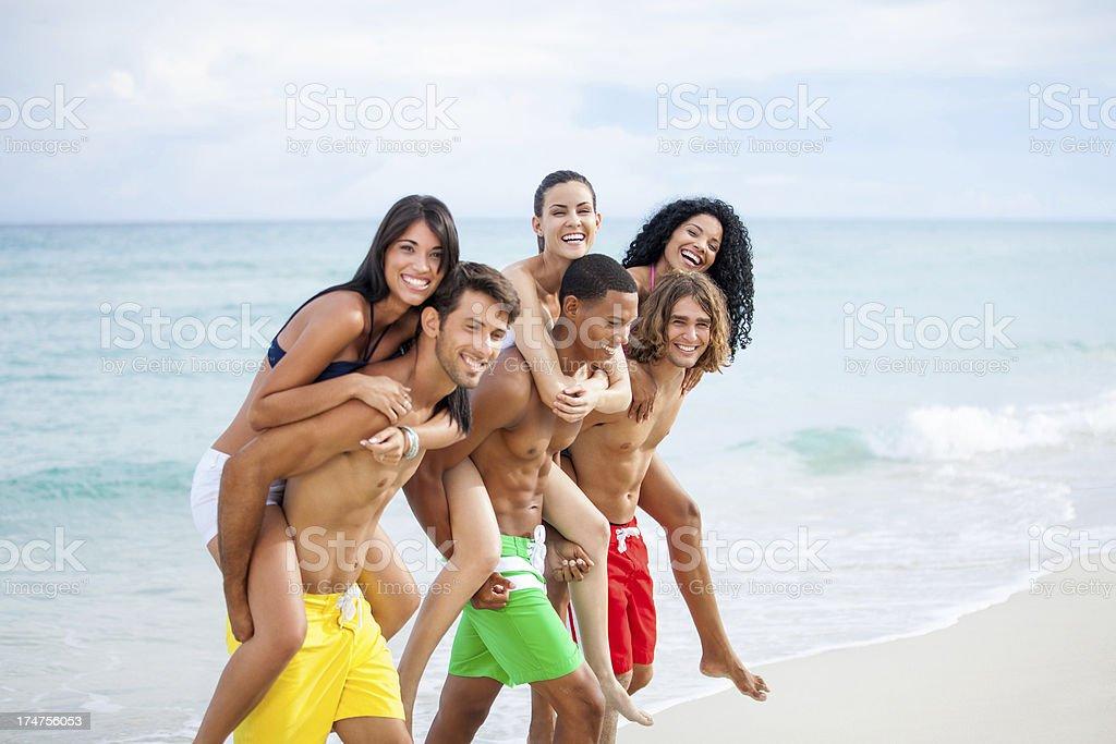 Friends having fun on the beach royalty-free stock photo