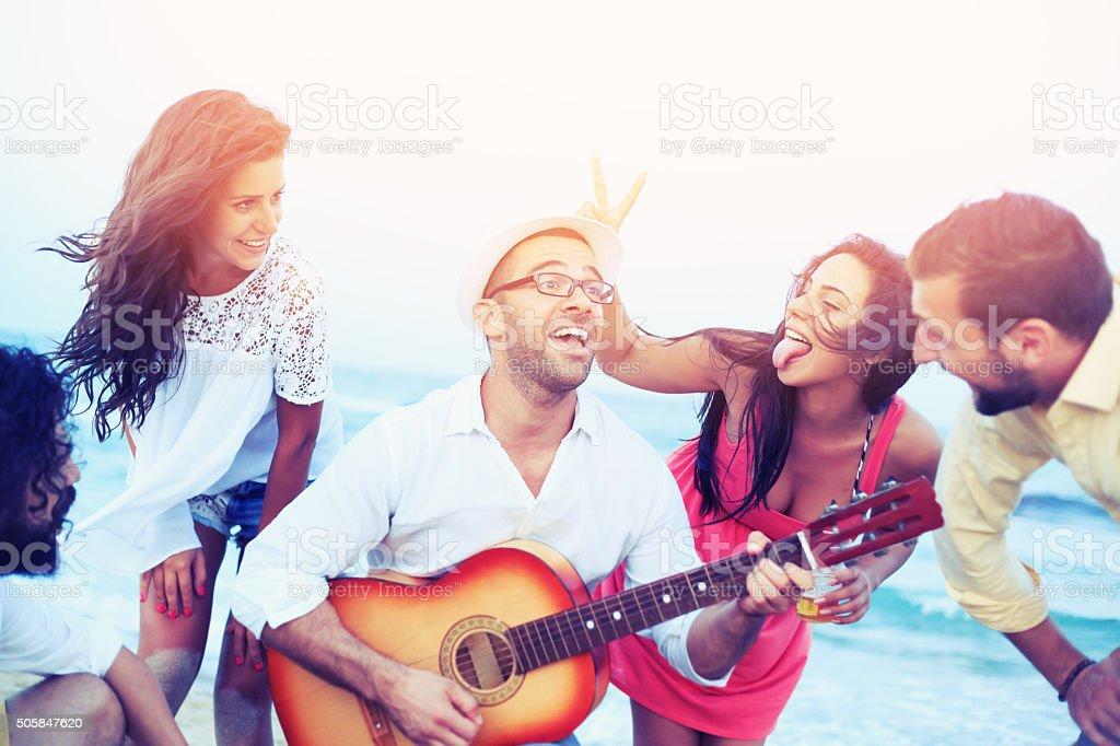 Friends having fun on the beach stock photo