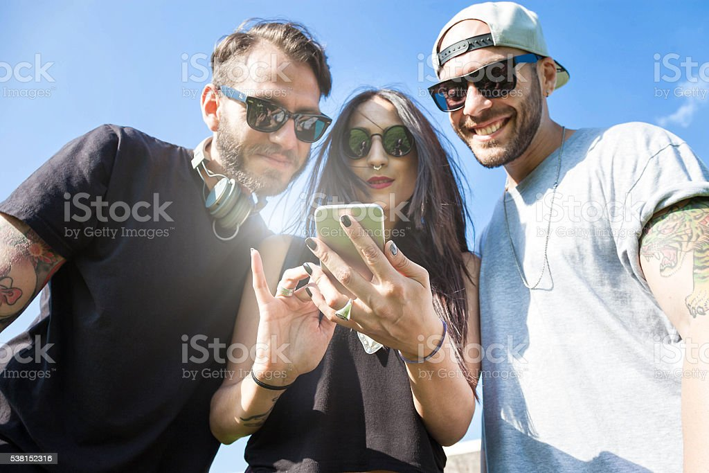 Friends having fun outdoors at the park stock photo