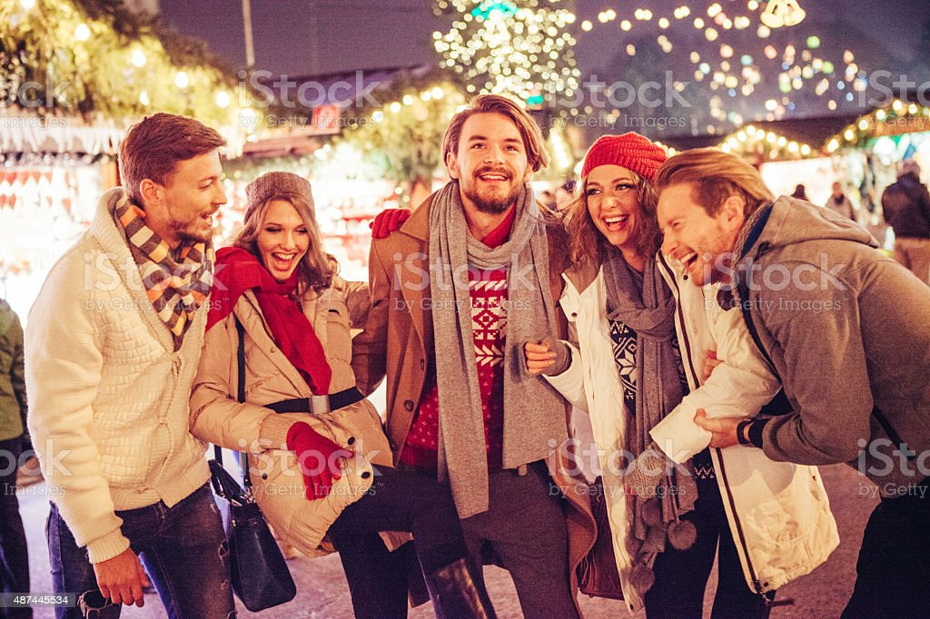 Friends having fun outdoors at winter holidays. stock photo
