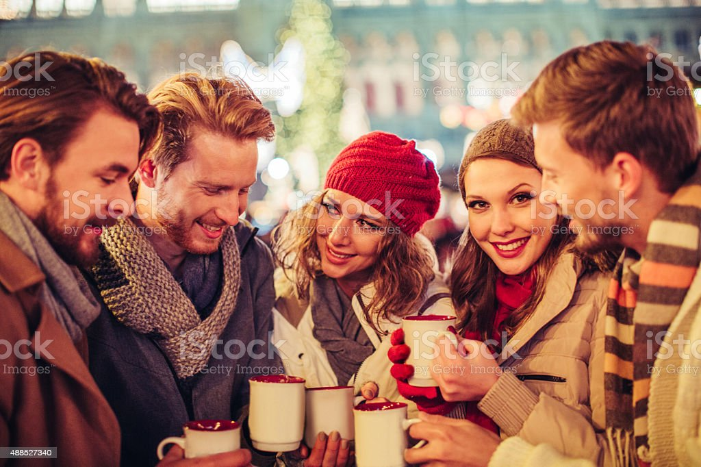 Friends having fun outdoors at winter holidays. stock photo