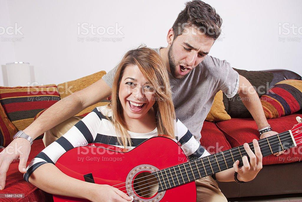 Friends having fun playing guitar royalty-free stock photo