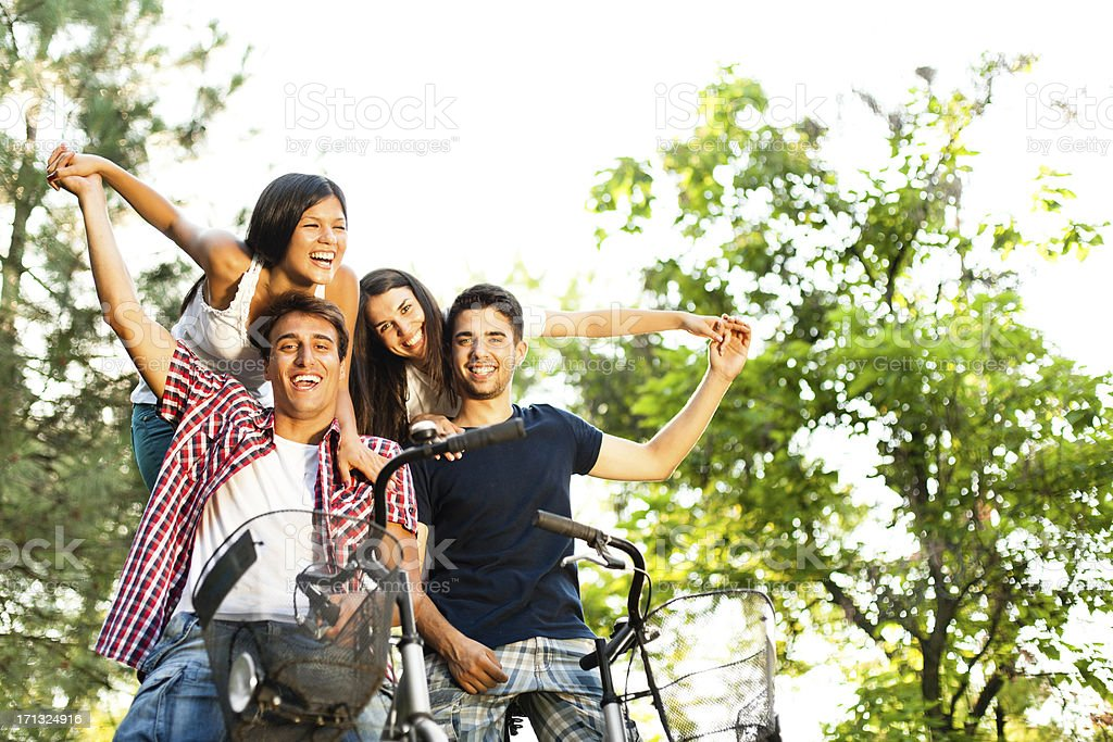 Friends having fun, riding bicycles royalty-free stock photo