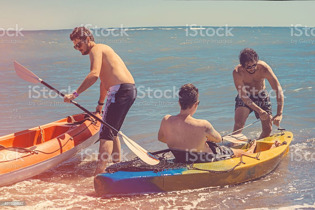 friends having fun with kayak stock photo
