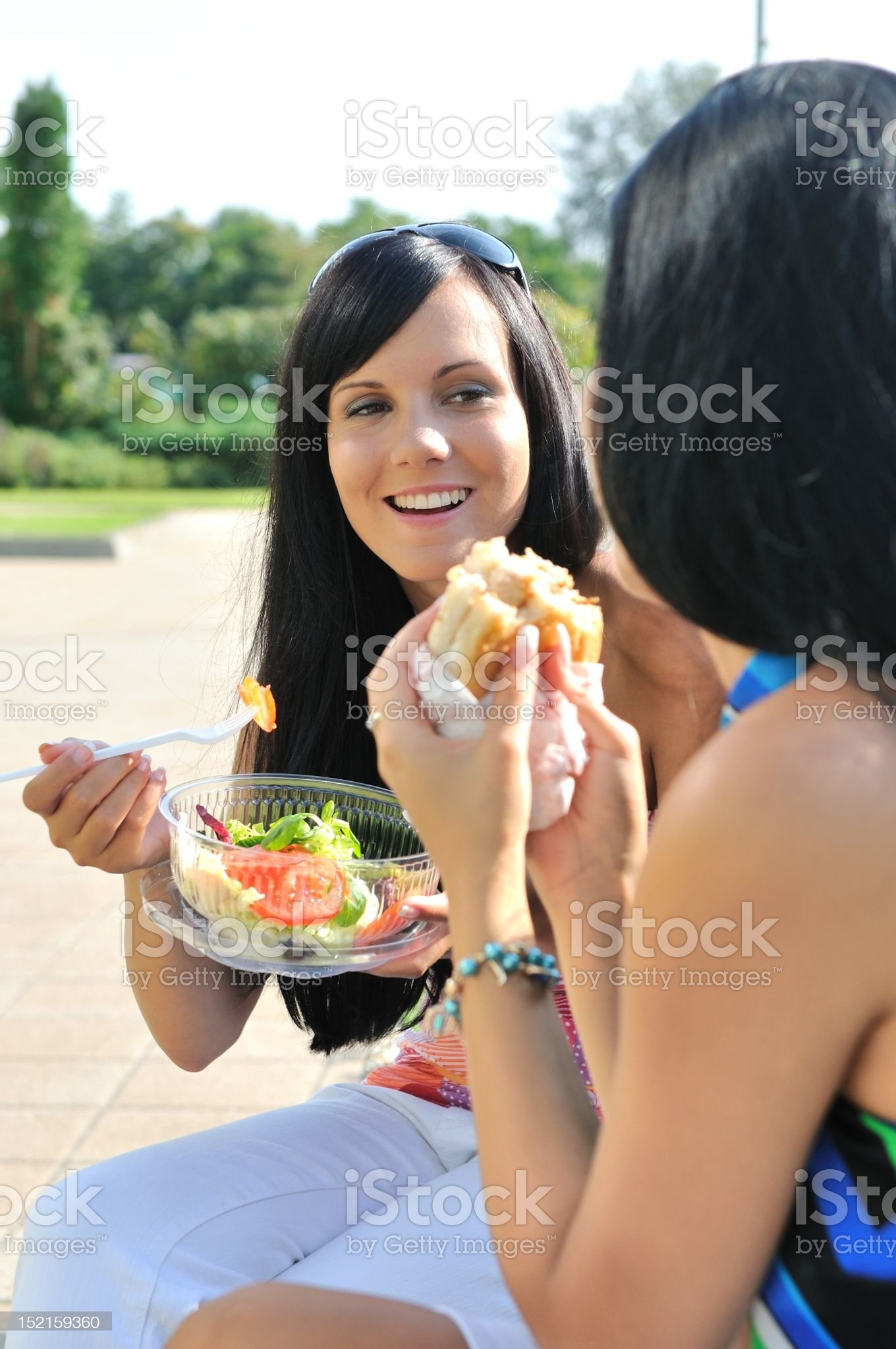 Friends having great time when eating outdoors royalty-free stock photo