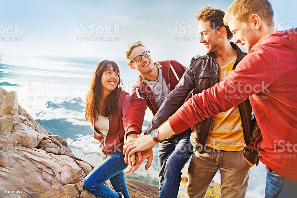 Friends having reached the top of a mountain stock photo