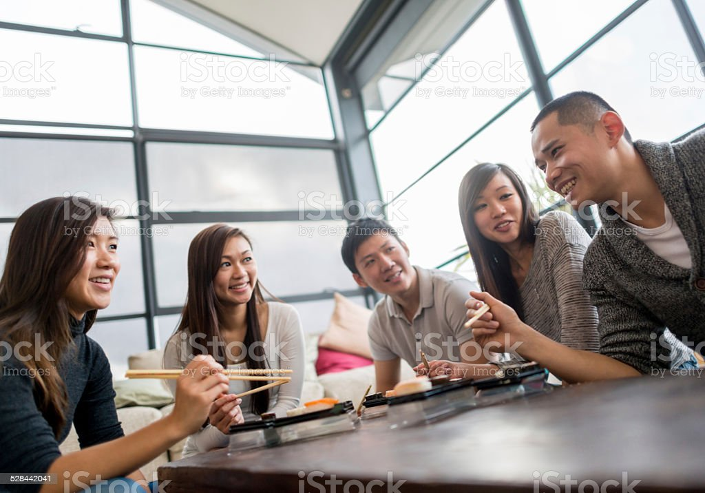 Friends having sushi stock photo