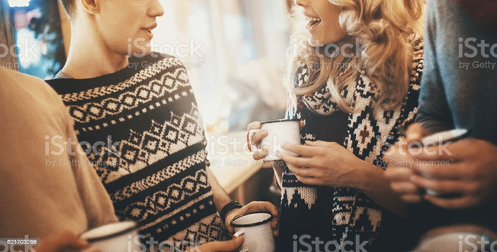 Friends having tea at coffee house. stock photo