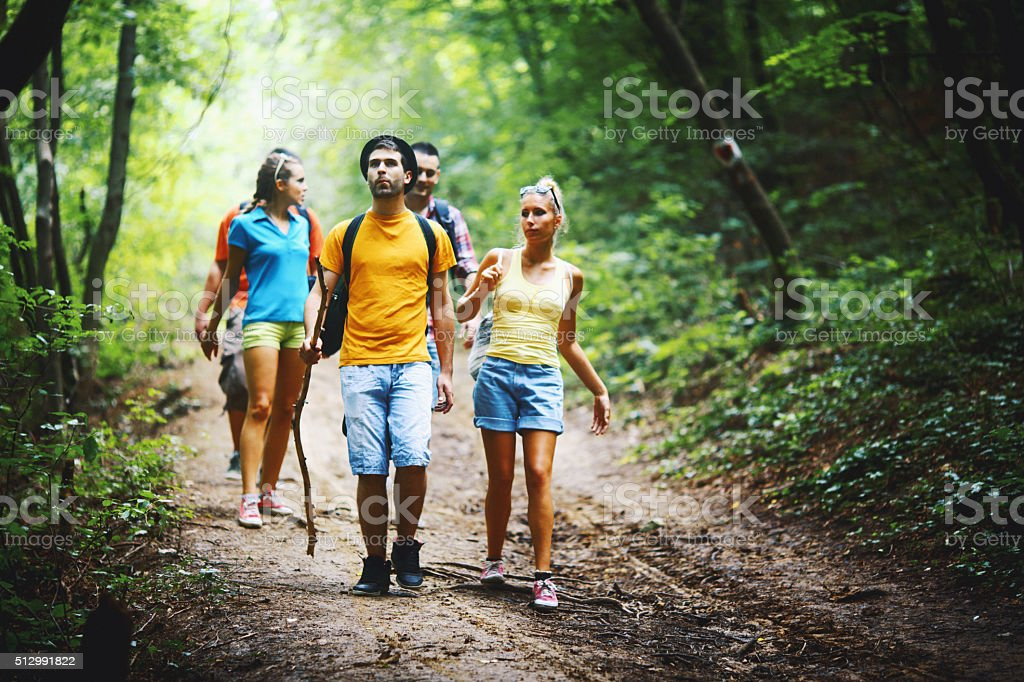 Friends hiking in forest. stock photo
