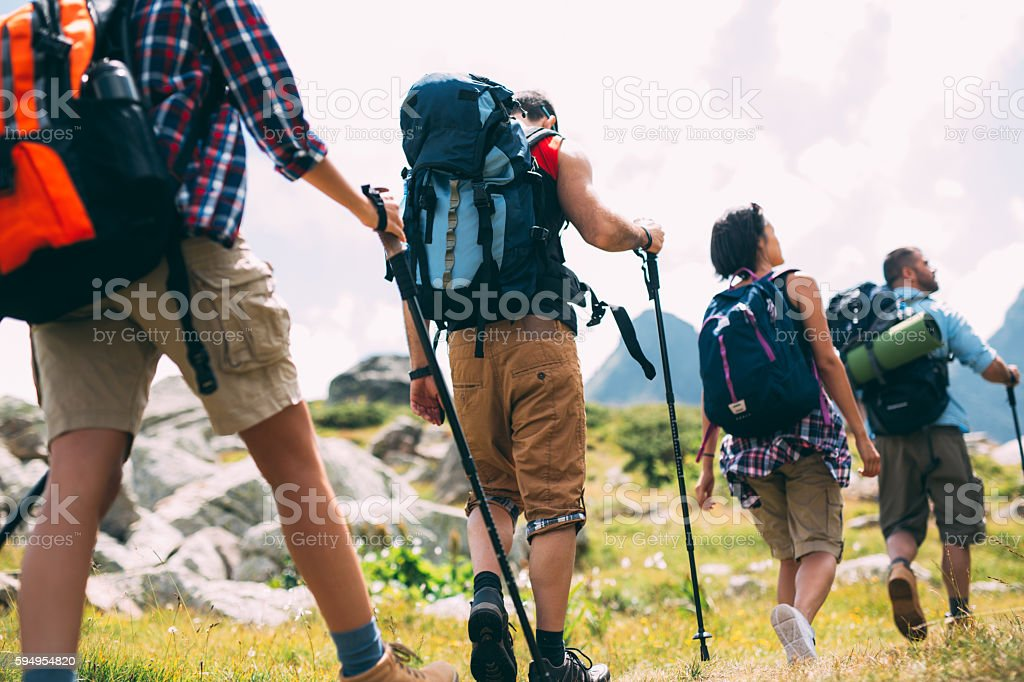 Friends hiking in the mountain stock photo