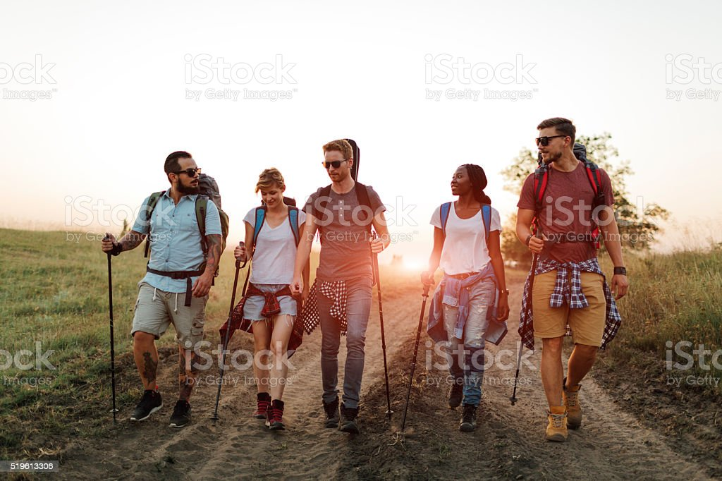 Friends Hiking Together. stock photo