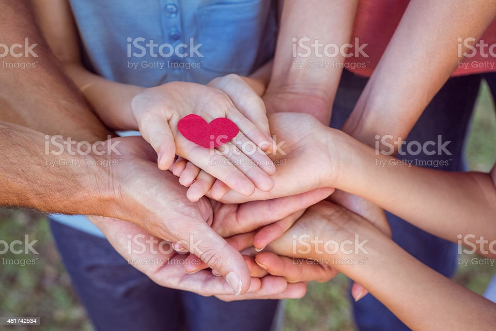 Friends holding a heart stock photo
