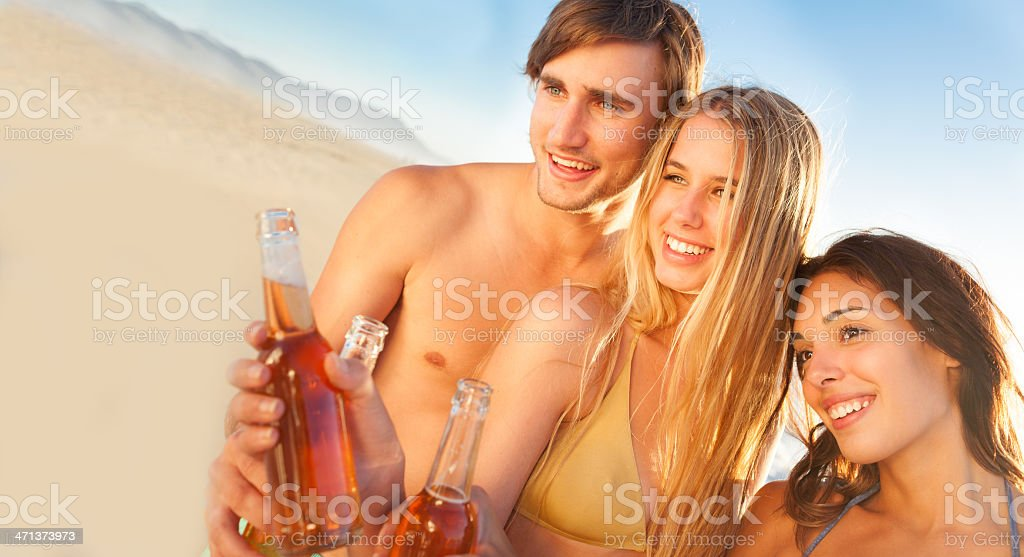 Friends Holding Beer Bottles royalty-free stock photo