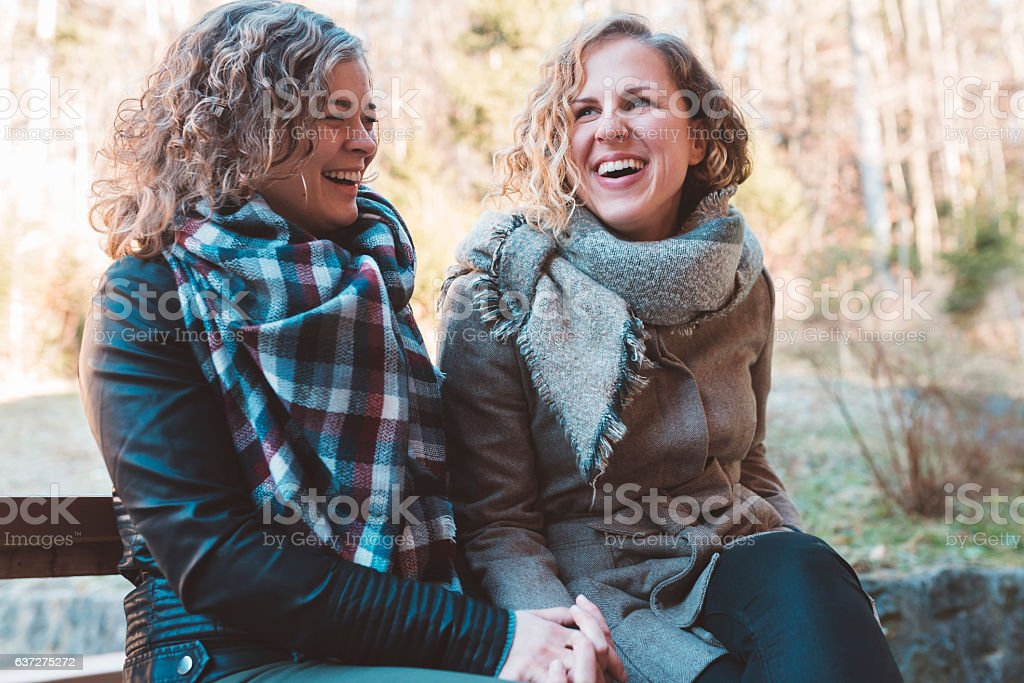 Friends holding hands in Winter stock photo