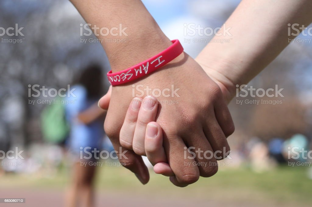 Friends Holding Hands stock photo