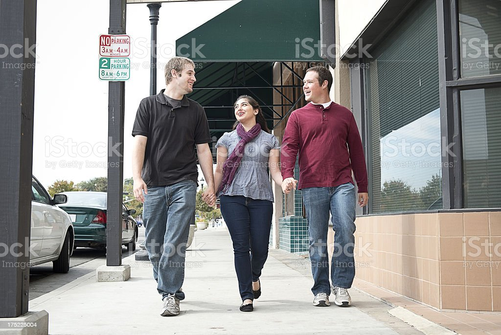 Friends Holding Hands, Walking Down the Street royalty-free stock photo