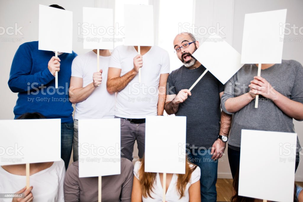 Friends holding mark signs in front of their faces royalty-free stock photo
