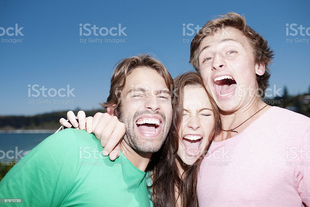 Friends hugging and laughing royalty-free stock photo