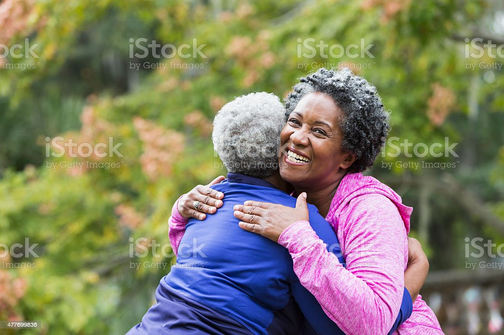 Friends hugging stock photo