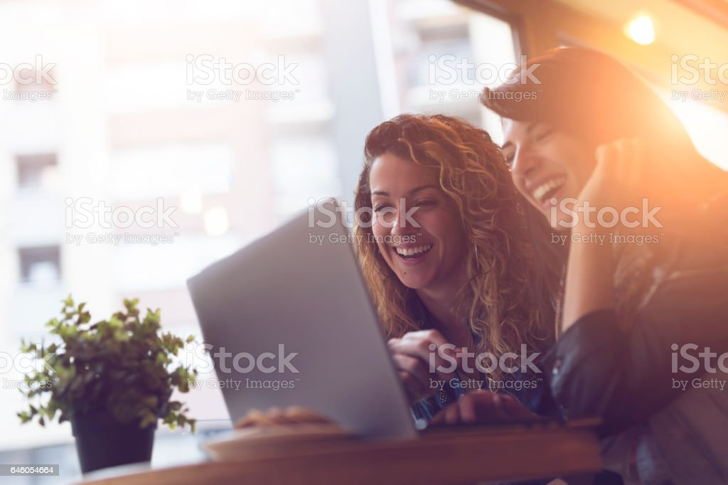 Friends in a cafe stock photo