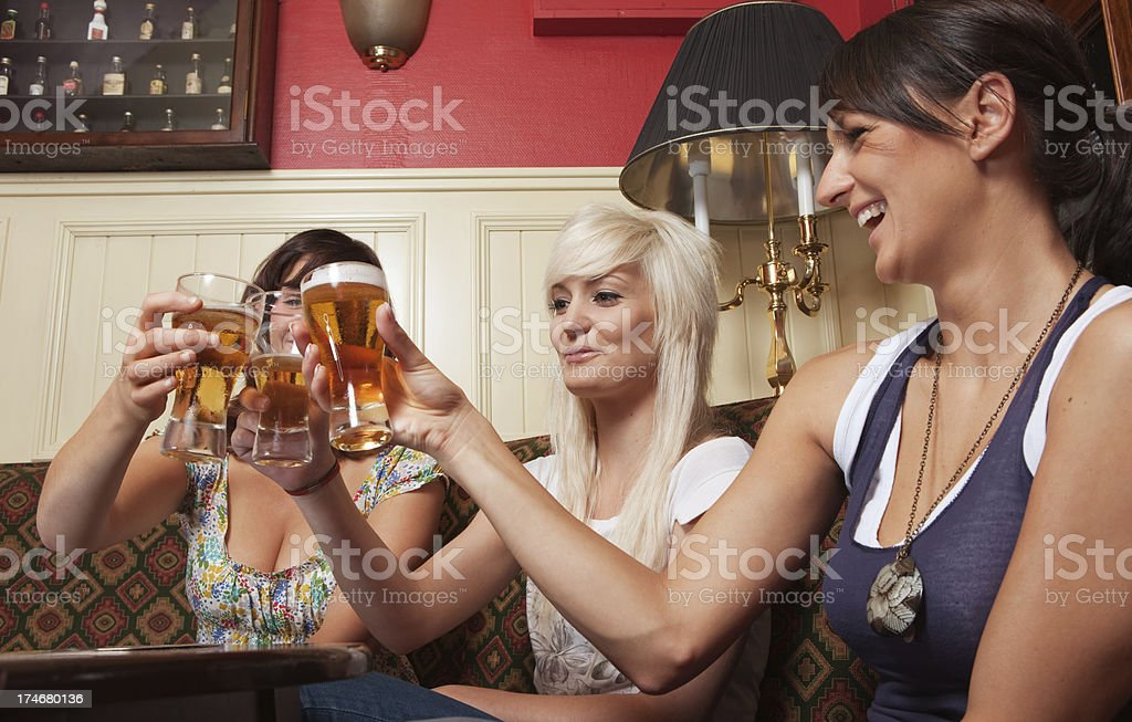 Friends in a pub royalty-free stock photo