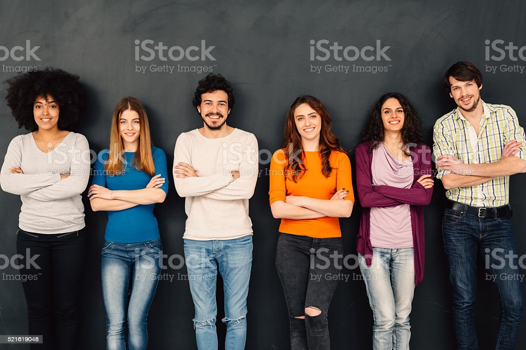Friends in a row against blackboard stock photo