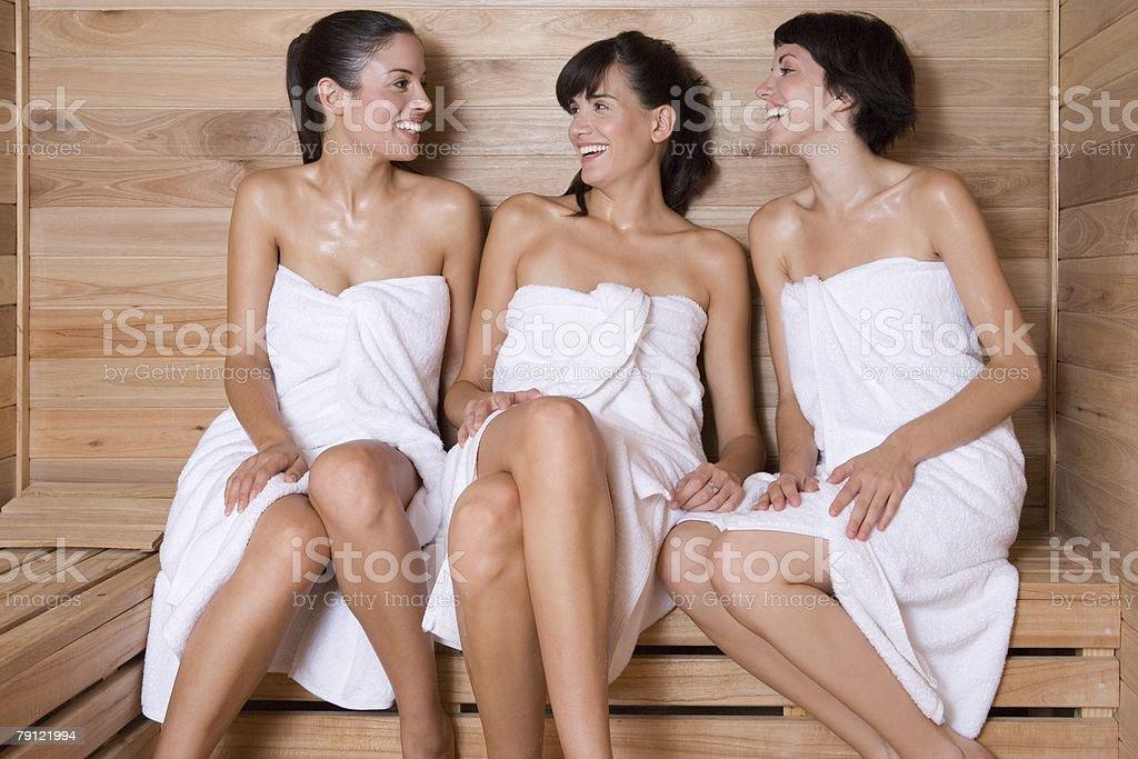 Friends in a sauna stock photo