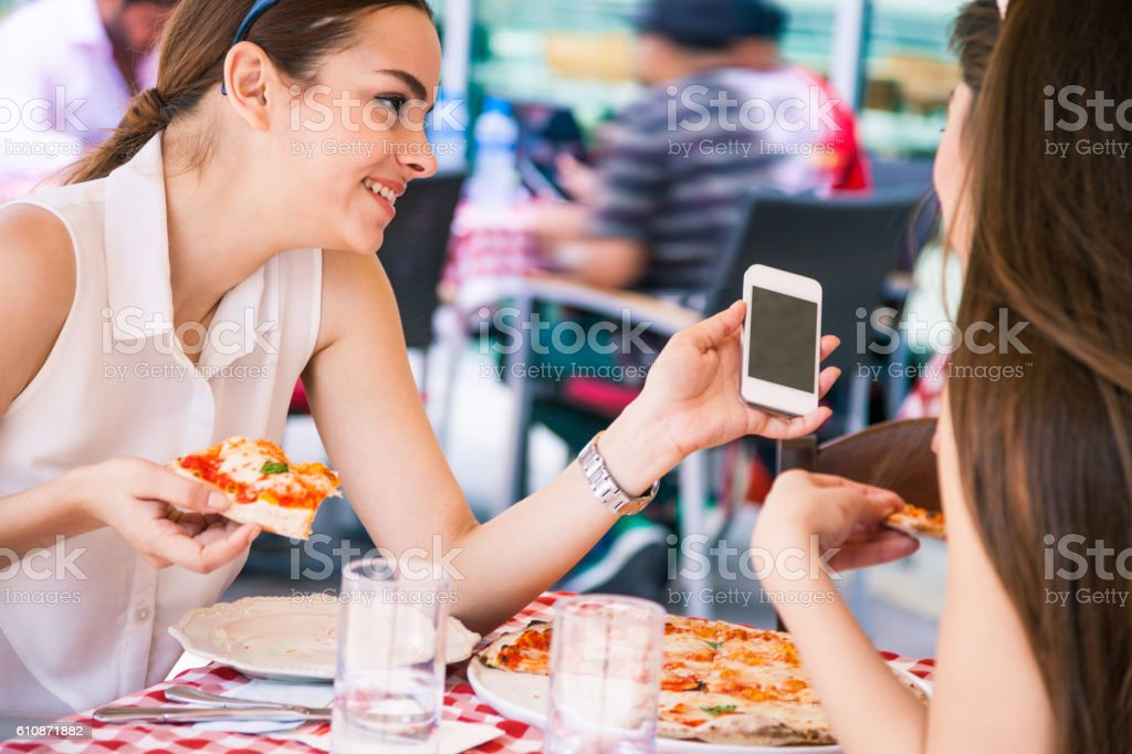 Friends in a sidewalk restaurant stock photo