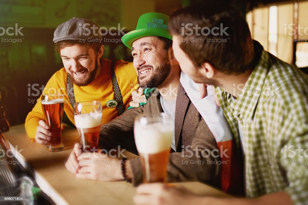 Friends in Bar on St.Patrics Day stock photo