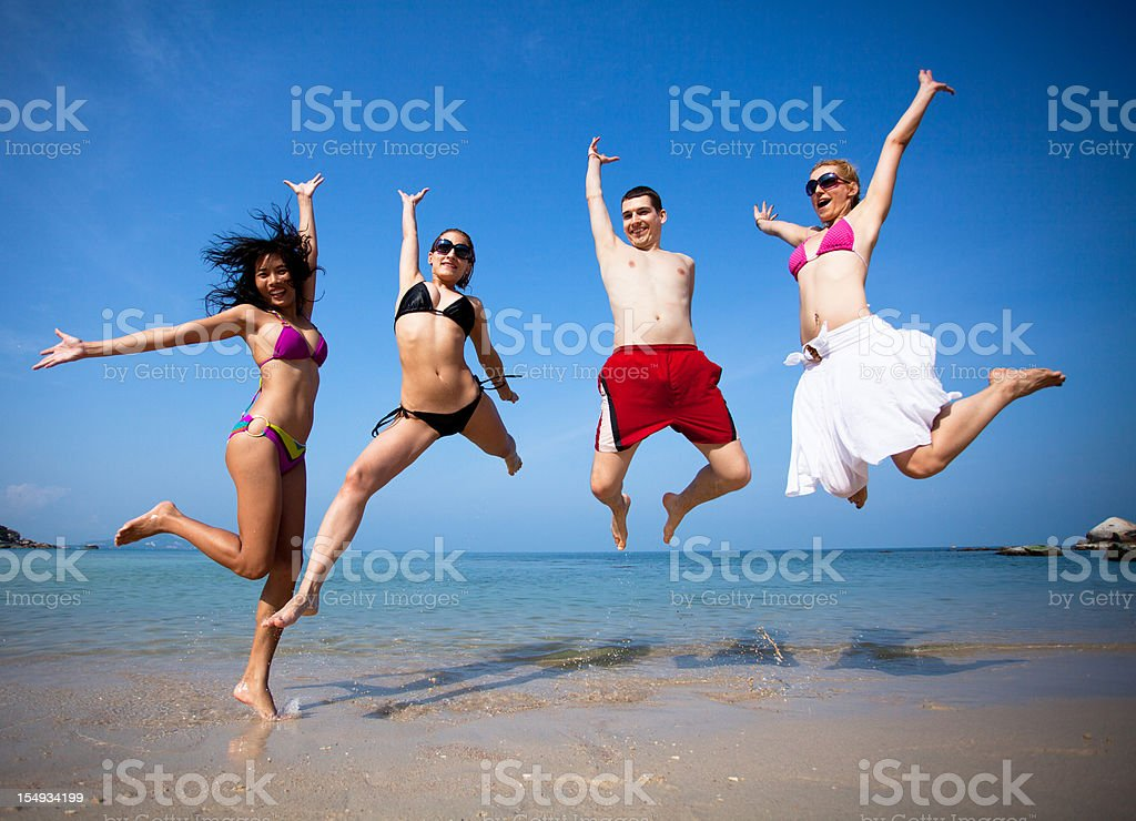 Friends in beach royalty-free stock photo