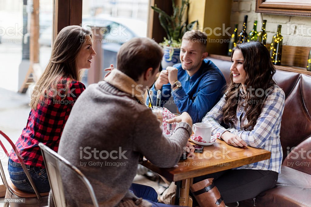 Friends in cafe having coffee stock photo