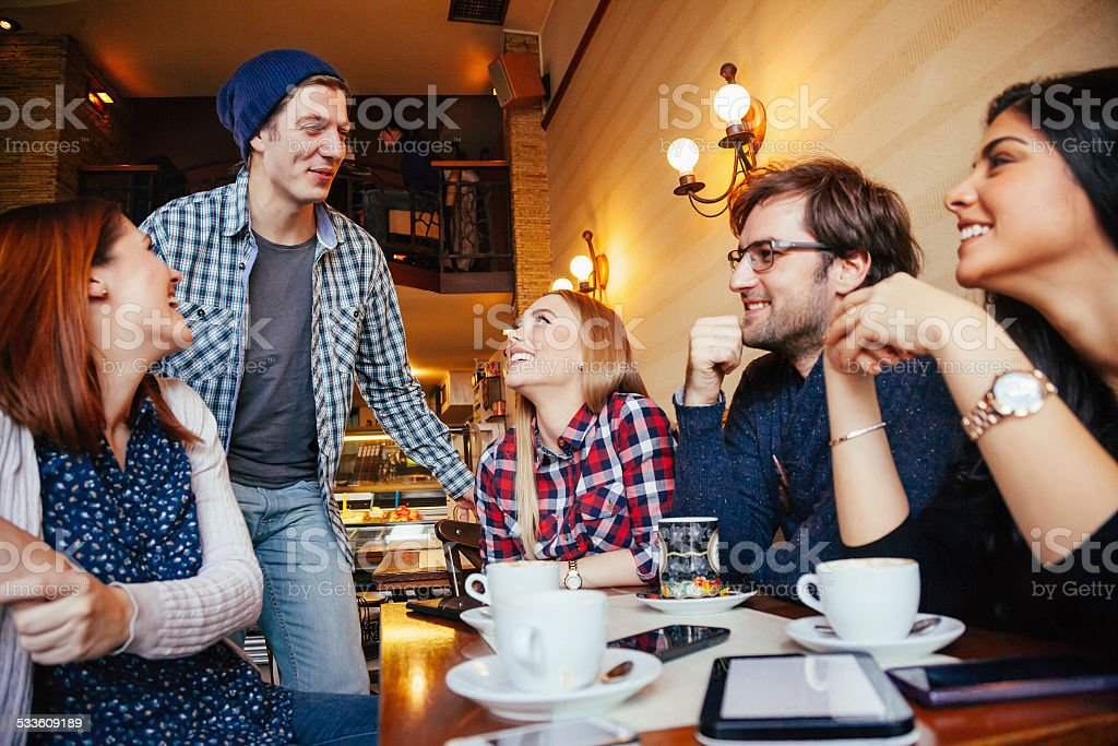 Friends In Cafe stock photo