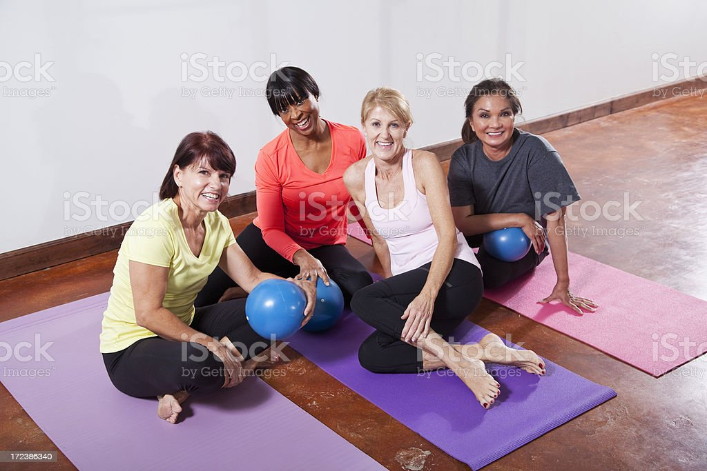 Friends in exercise class with fitness balls stock photo