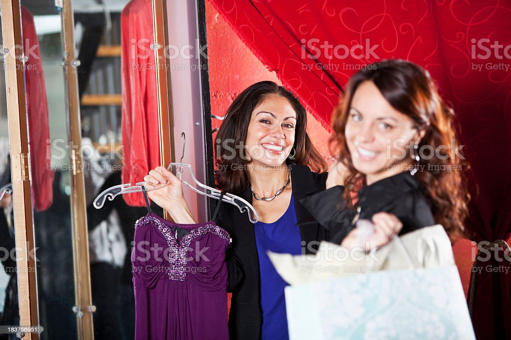 Friends in fitting room of clothing store royalty-free stock photo