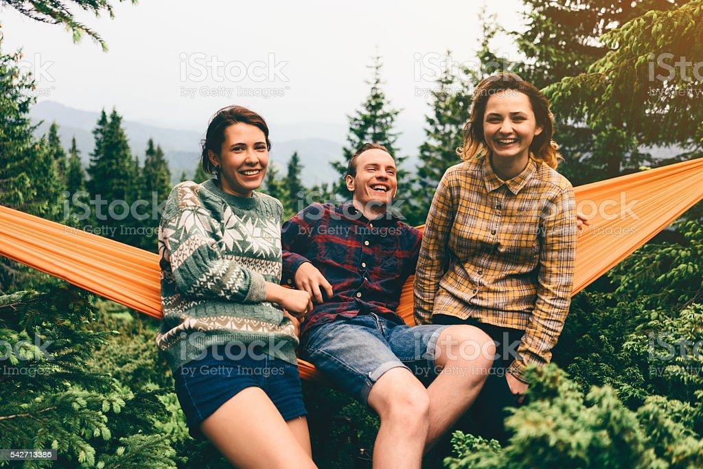 Friends in hammock stock photo