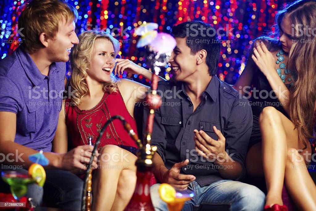 Friends in hookah room stock photo